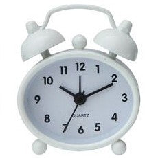 Miniature retro metal alarm clocks green, gray, white, and black