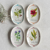 Oval shaped stoneware dishes with floral designs.