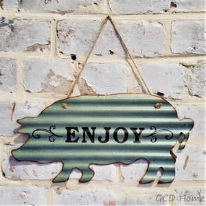 "Gray Waffle Tin ""Enjoy"" Sign Shaped as a Pig."