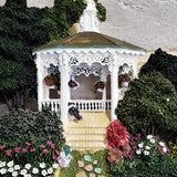 Hand Painted Wall Hanging of an ornate Gazebo surrounded by Trees and flowers.