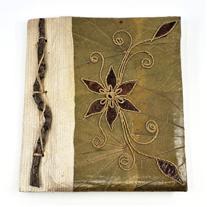 Green and brown handmade teak leaf notebook with bamboo paper.