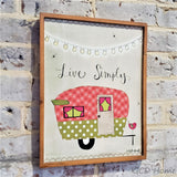 "Retro Camper ""Live Simply"" Wall Decor with raised wooden frame."