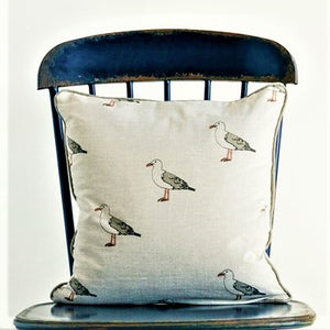 Square shaped pillow with seagull design.