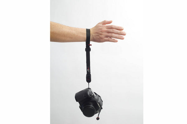 Cuff strap with DSLR hanging from wrist