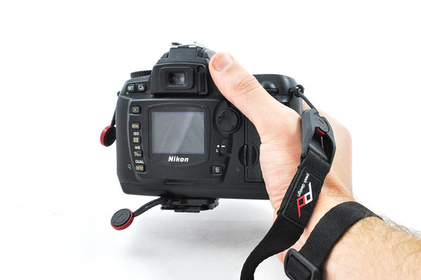 Camera Cuff attached to wrist and DSLR