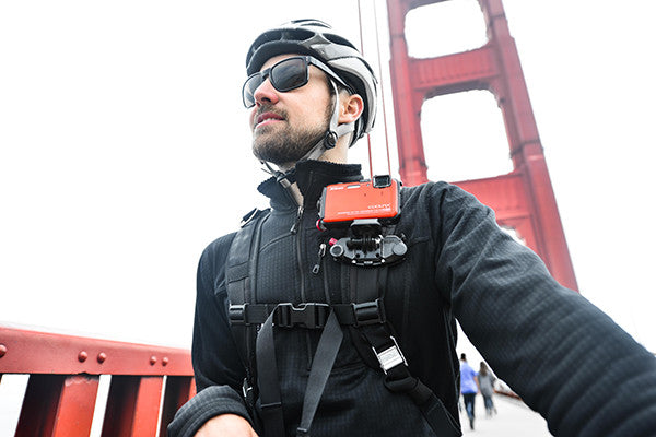 Attach a small camera to the POV kit and cycle around town