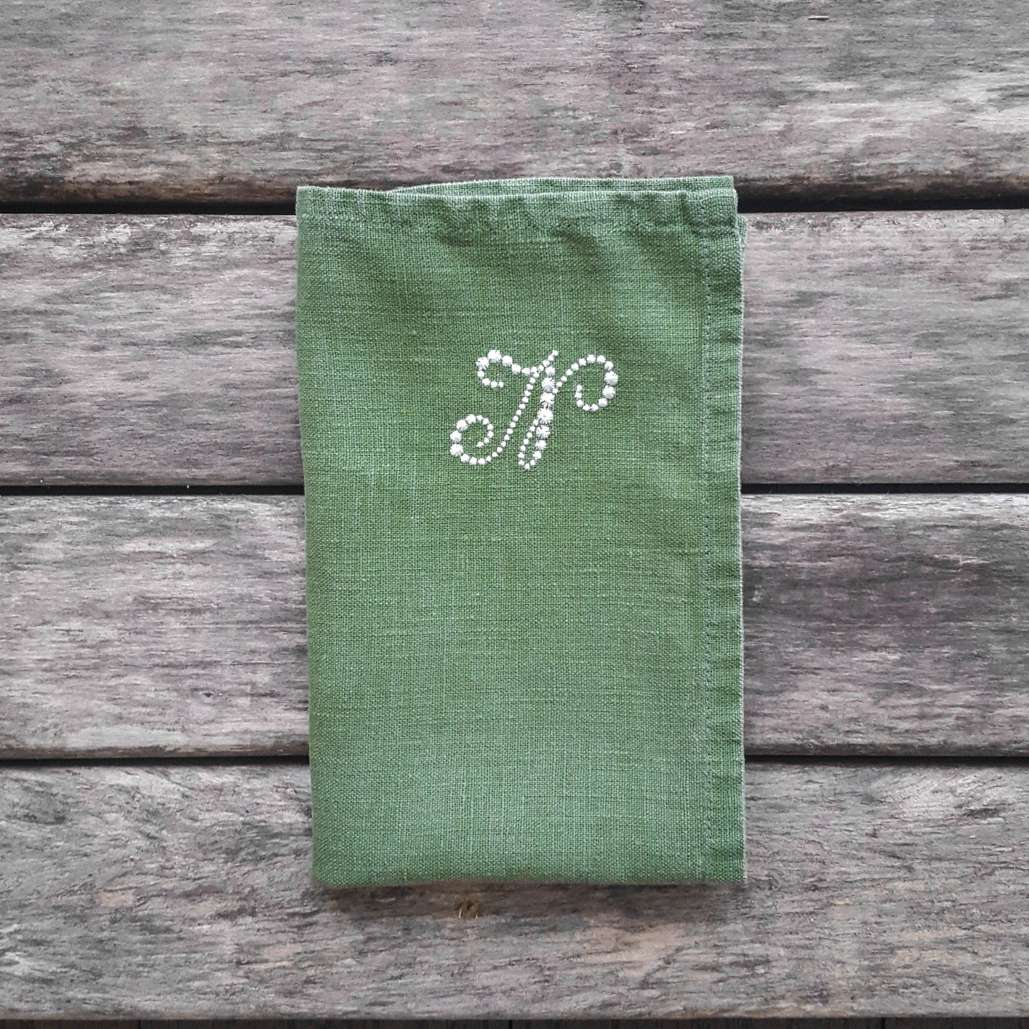 Monogrammed linen napkins in various colors. Stars font.