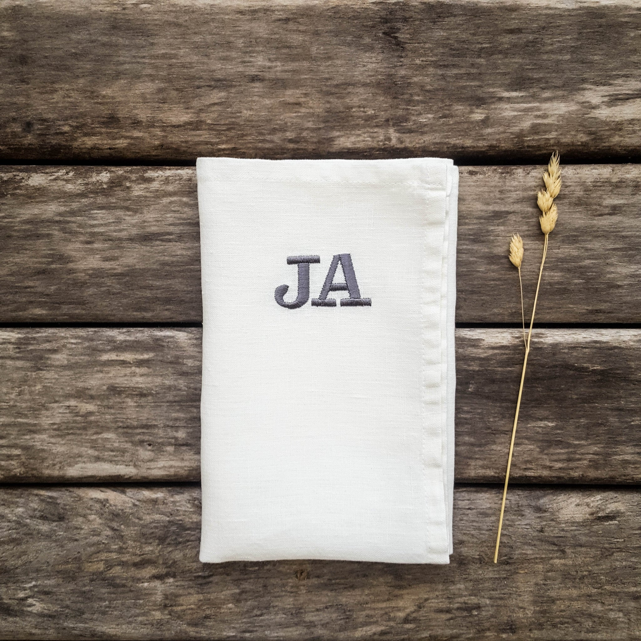 Monogrammed linen napkins in various colors. Clarendon font.