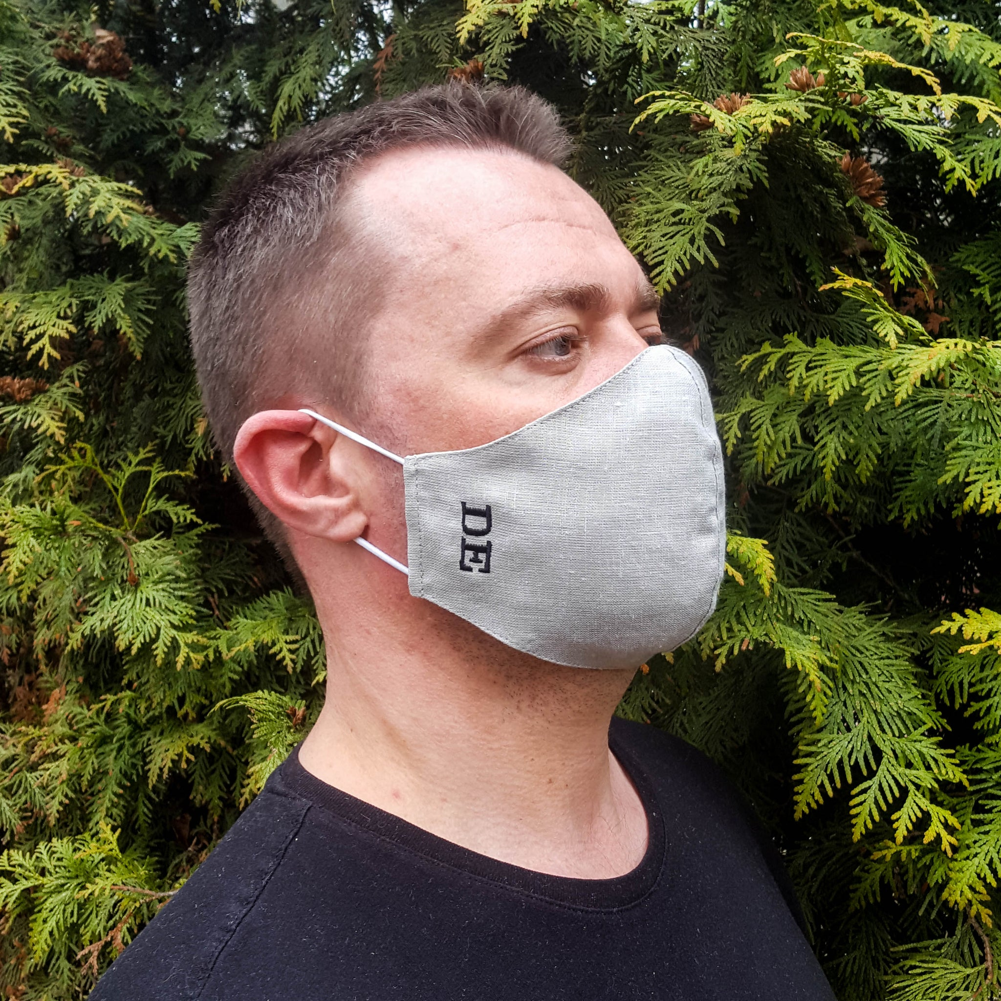 Light gray linen face mask with an insert for filter