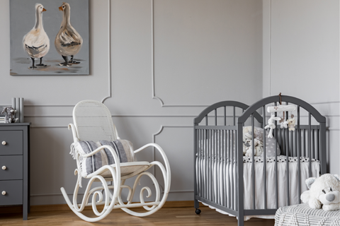 Gray nursery furniture with white rocking chair