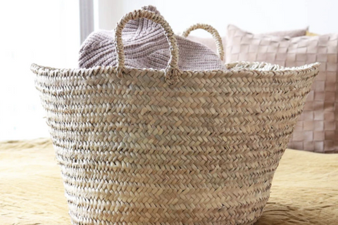 Basket filled with throw blankets