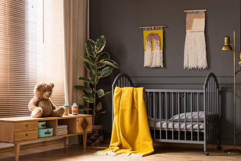 Black nursery decor with yellow pop of color