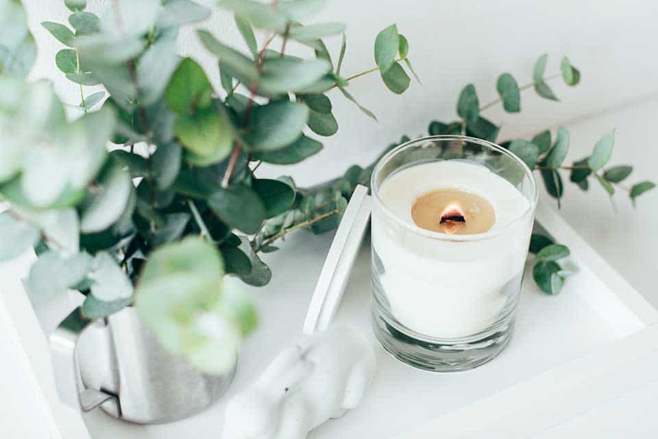 Vanilla-scented candle on a tray