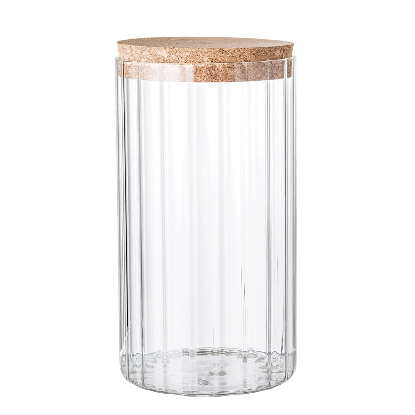 Tall glass ribbed jar with a cork lid