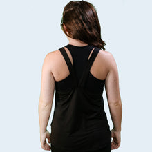 Model shot from the back of Joanna Wilson wearing a black training vest. TSKIR