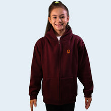 Model shot of a girl wearing a burgundy children's hoodie. With the Nile Wilson NW logo on the front. Nile Wilson Clothing