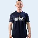 Model shot of Nile Wilson wearing a navy blue Train Smart Keep It Real logo T-Shirt. TSKIR