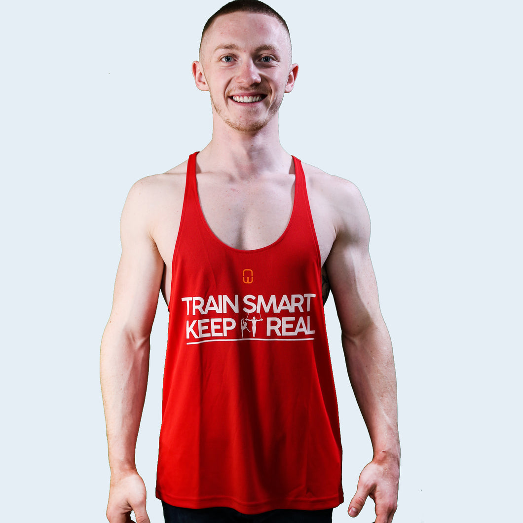 Model shot of Nile Wilson wearing a red training vest with the Train Smart Keep It Real logo on the front. TSKIR