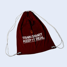 Burgundy drawstring bag. With Train Smart Keep It Real logo on.