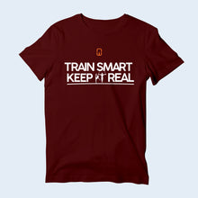 Nile Wilson Clothing Burgundy Train Smart Keep It Real kids' T-Shirt. Nile Wilson logo in orange and white writing across the chest.