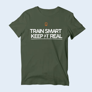 Nile Wilson Clothing Green Train Smart Keep It Real kids' T-Shirt. Nile Wilson logo in orange and white writing across the chest.