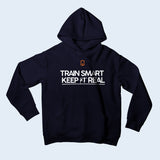 Nile Wilson Clothing Navy Kid's Hooded Top. Nile Wilson Logo in orange on the chest area, with the Train Smart Keep It Real Logo on the chest in black.