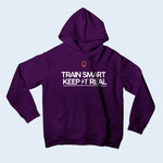 Nile Wilson Clothing Purple Kid's Hooded Top. Nile Wilson Logo in orange on the chest area, with the Train Smart Keep It Real Logo on the chest in black.