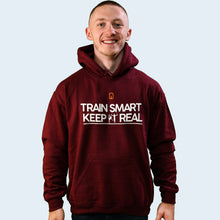 Model shot of Nile Wilson wearing an adult burgundy Train Smart Keep It Real logo Hoodie. TSKIR