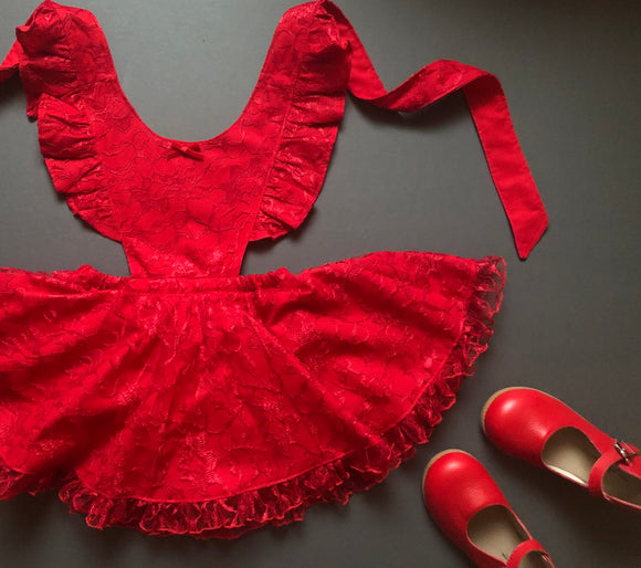 Fully lined red lace pinny- regular tat 4-6 weeks
