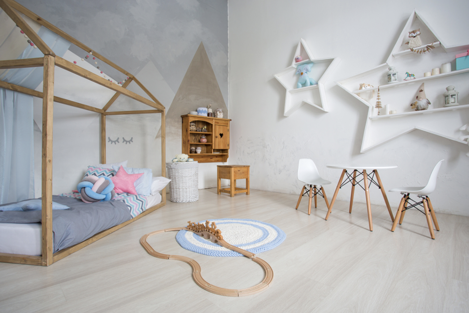 a childs room full of furniture and decorations