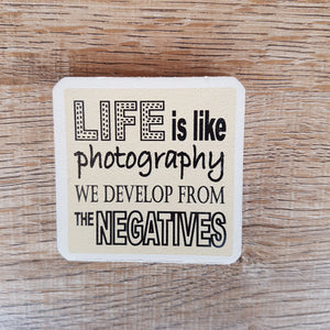C&F Wooden Quote Magnet - We Develop From The Negatives