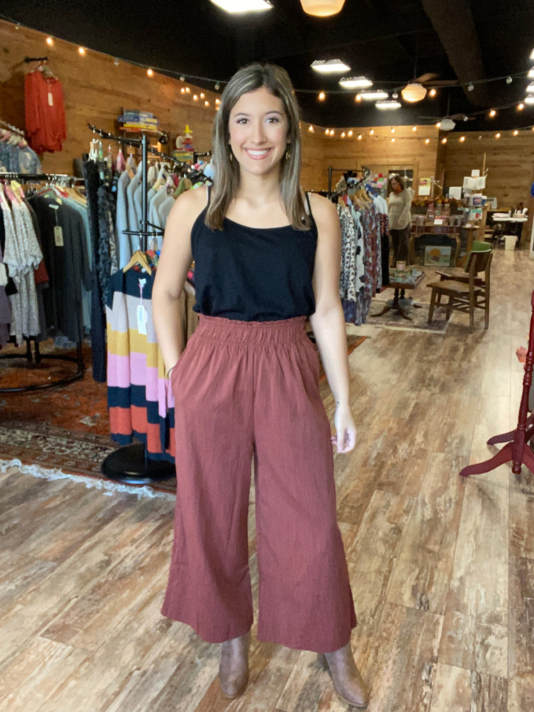 Rust Shirred Waist Wide Leg Pants. Polyester/Rayon