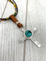 Changing cross necklace