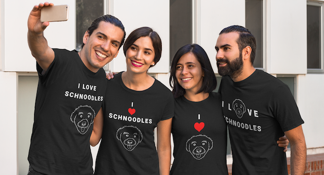 """Two men and two women posing for a selfie wearing T-Shirts from the """"I love schnoodles"""" collection at The Schnoodle Show."""
