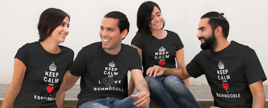 """Two men and two women wearing T-Shirts from the """"Keep Calm and Love a Schnoodle"""" collection at The Schnoodle Show."""
