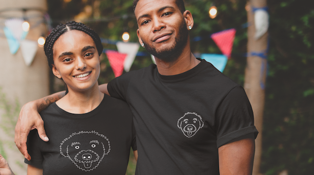 """One man and one woman wearing various T-Shirt designs from the """"Signature Schnoodle"""" collection at The Schnoodle Show."""