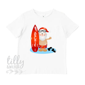 Surfing Santa Personalised Christmas T-Shirt, Aussie Xmas, Australian Summer Xmas, Beach Santa With Surf Board, Christmas Overseas, Boys Tee