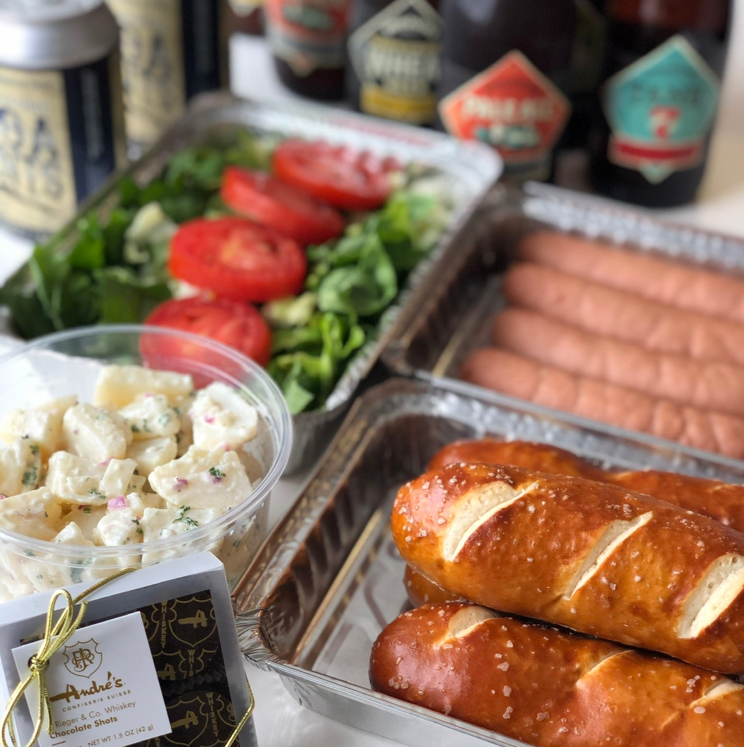 Beer N Brats Pack (Bratwurst or Knackwurst w/Bread, Salads, Beers & Chocolates for 4) Pick up at 5018 Main St.