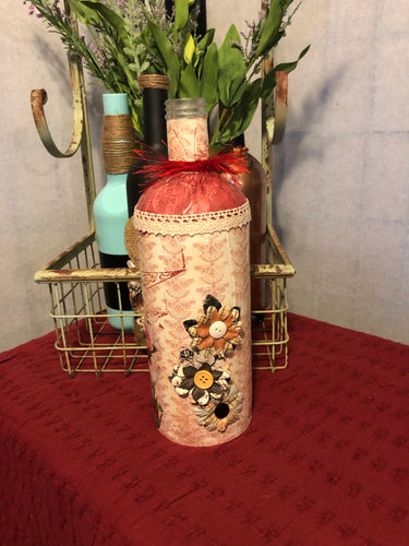 Altered wine bottle with flowers