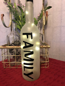 "Frosted ""FAMILY"" wine bottle with lights."