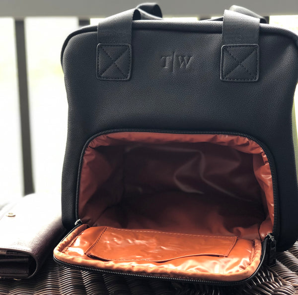 black exterior bag with cognac interior color