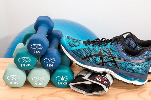A stack of dumbbells and a running shoe