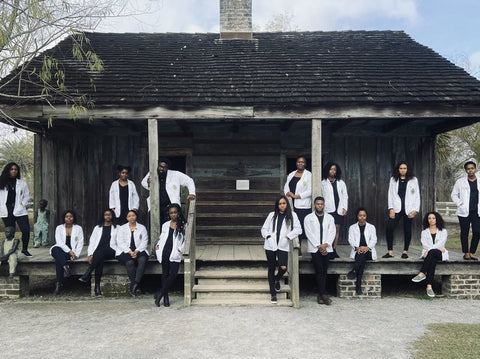 15 African American students from Tulane University stand at the Whitney Plantation in Louisiana. (Russell Joseph Ledet)