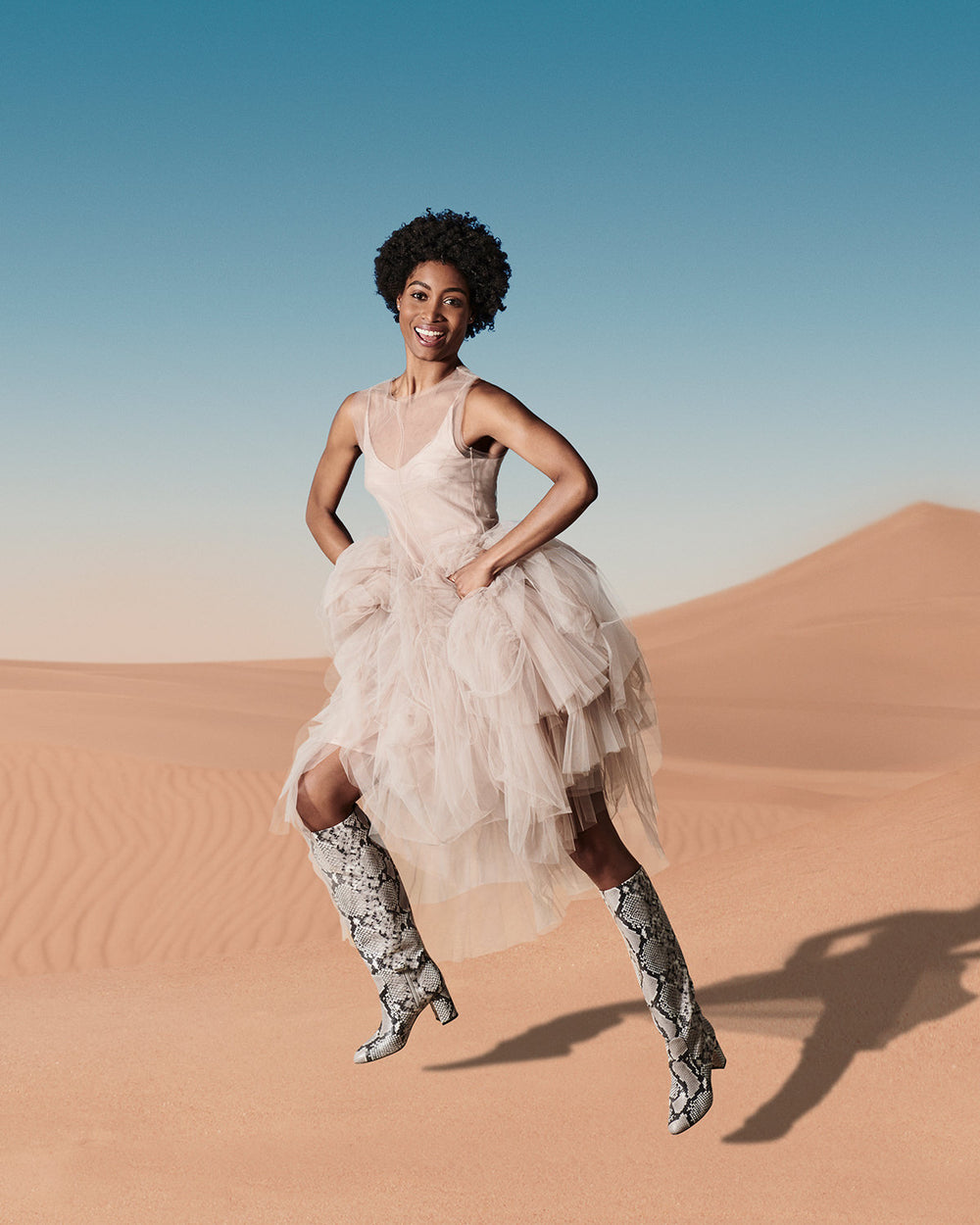 Aera Campaign. Women jumping in the desert with Giselle boots.