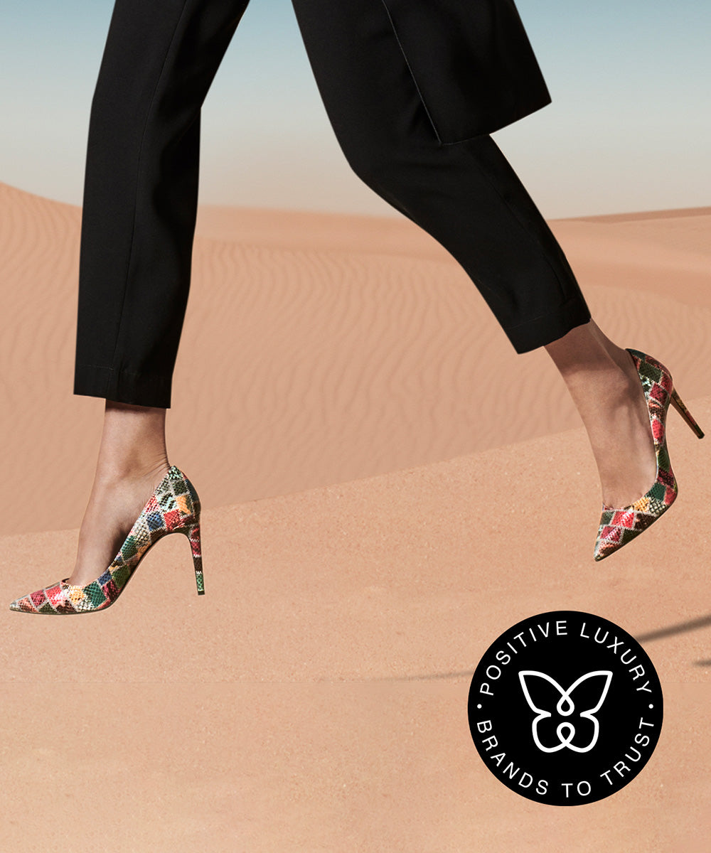 AERA Campaign. Legs with AERA shoes jumping in the desert