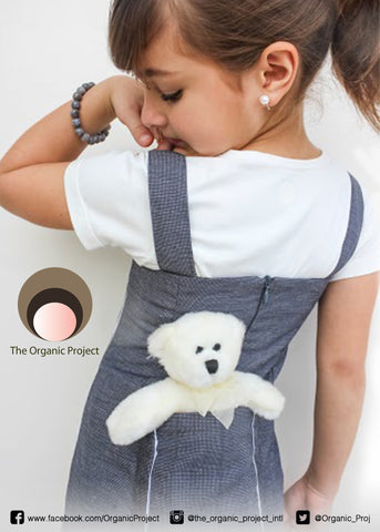 girls grey blue strappy dress with a big back pocket large enough to carry a furry friend.  Worn with our without a under shirt.  Strappy mid-wight kids dress in organic and recycled fabric.  a different and uniqe style of girls dresses.  Kids clothes on Sale now at The Organic Project