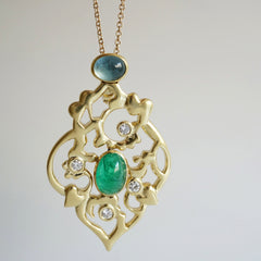 gold pendant with emerald, aquamarine and diamonds