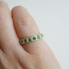 white diamonds with tsavorites in yellow gold ring