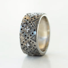 oxidized white gold diamond band with diamonds