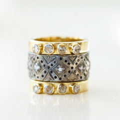 wedding band and engagement ring in gold with diamonds